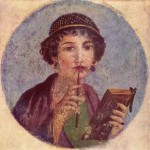 A fresco from Pompei showing a woman with a stylus and book.